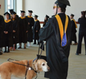 Grad Student, Guide Dog Lead McCormack Graduates at Commencement
